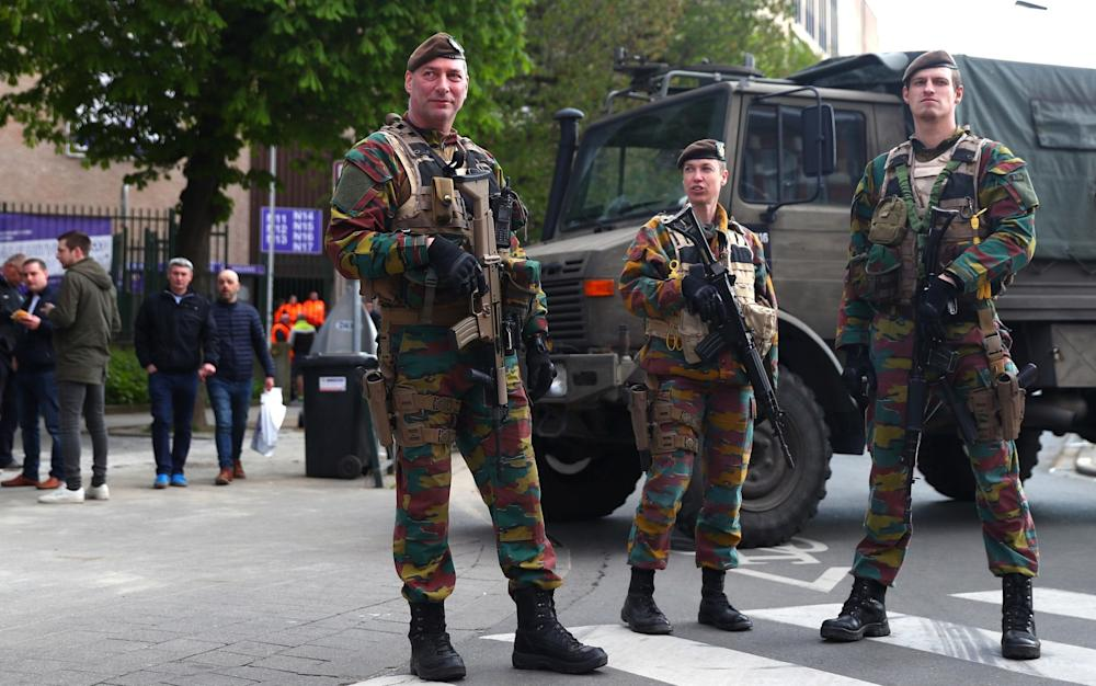 Belgian security forces patrol outside the stadium in numbers after Tuesday's bomb attack in Dortmund - Credit: Clive Rose/Getty Images