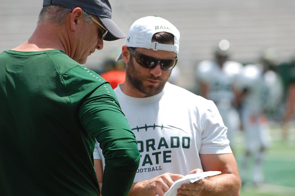 CSU safety's coach George Helow talks with Rams defensive coordinator John Jancek before the Aug. 4 scrimmage at Canvas Stadium