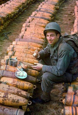 """American combat engineers eat a meal atop boxes of ammunition stockpiled for the impending D-Day invasion, May 1944. (Frank Scherschel—Time & Life Pictures/Getty Images) <br> <br> <a href=""""http://life.time.com/history/d-day-rare-color-photos/#1"""" rel=""""nofollow noopener"""" target=""""_blank"""" data-ylk=""""slk:Click here"""" class=""""link rapid-noclick-resp"""">Click here</a> to see the full collection at LIFE.com"""