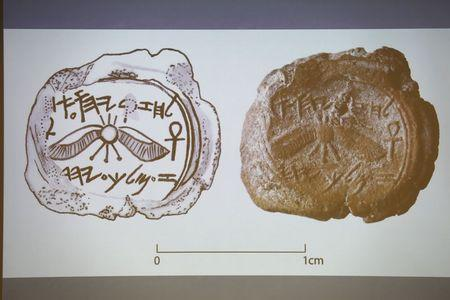 A projected image of a clay imprint, which was unearthed from excavations near Jerusalem's Old City, is displayed during a news conference at Hebrew Uni