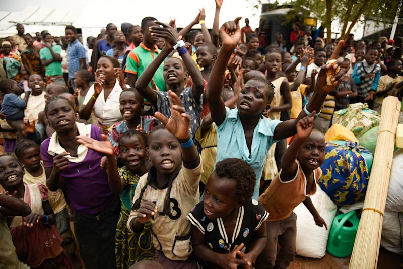 Newly arrived children refugees from the Democratic Republic of Congo (DRC) start singing before registration process at Kyangwali Refugee Settlement in Kyangwali, western Uganda, on December 10, 2018. - In the last year, more than 123,000 Congolese refugees have arrived in western Uganda. (Photo: Isaac Kasamani/AFP via Getty Images)