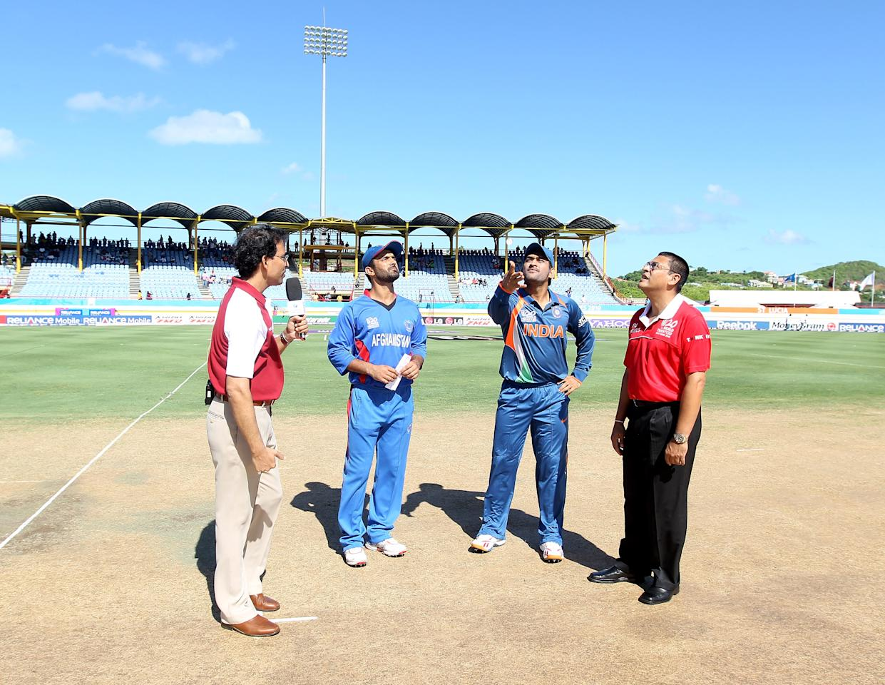 GROS ISLET, SAINT LUCIA - MAY 01: Nowroz Mangal of Afghanistan (L) and M S Dhoni of India take part in the coin toss before the ICC World Twenty20 Group A match between India and Afghanistan played at the Beausejour Cricket Ground  on May 1, 2010 in Gros Islet, Saint Lucia.  (Photo by Julian Herbert/Getty Images)