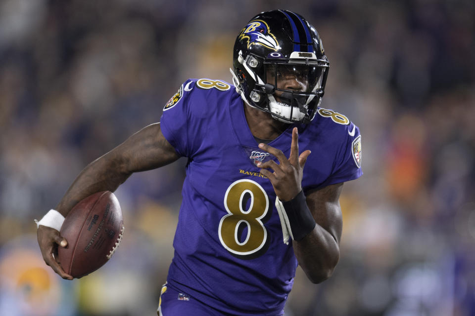 Lamar Jackson was the AFC's best player in November. (AP Photo/Kyusung Gong)