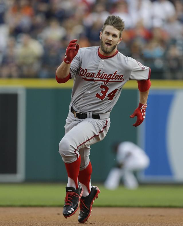 Washington Nationals' Bryce Harper heads to third during the first inning of a baseball game against the Detroit Tigers in Detroit, Tuesday, July 30, 2013. (AP Photo/Carlos Osorio)