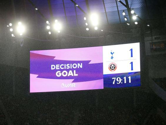 A screen inside the stadium displays a VAR check (Getty Images)