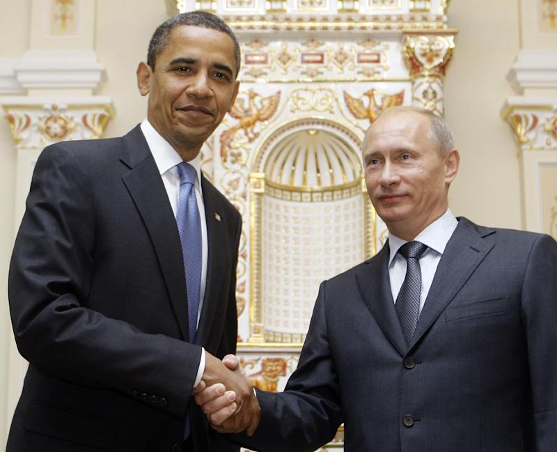 FILE - In this July 7, 2009 file photo, President Barack Obama shakes hands with then-Russian Prime Minister Vladimir Putin in Moscow. With global anxiety rising, President Barack Obama is searching for bolder, swifter signals from Europe that it will contain its fiscal mess and keep it from torpedoing the U.S. economy and his re-election chances along with it. Yet as he prepares to plunge into summit talks with the other world leaders, Obama is down to the power of persuasion and little else.  (AP Photo/Haraz N. Ghanbari, File)