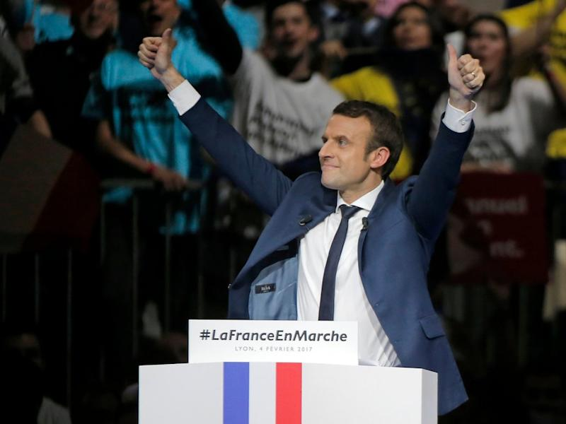 Presidential candidate Emmanuel Macron acknowledges applauses after his speech during a meeting in Lyon, central France, Saturday, Feb. 4, 2017. Untested former budget minister Emmanuel Macron, who rebelled against his Socialist masters to strike out on his own, could end up facing far-right presidential candidate Marine Le Pen in the second-round vote.