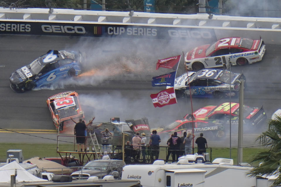 Cars collide in 13th lap during the NASCAR Daytona 500 auto race at Daytona International Speedway, Sunday, Feb. 14, 2021, in Daytona Beach, Fla. (AP Photo/Chris O'Meara)