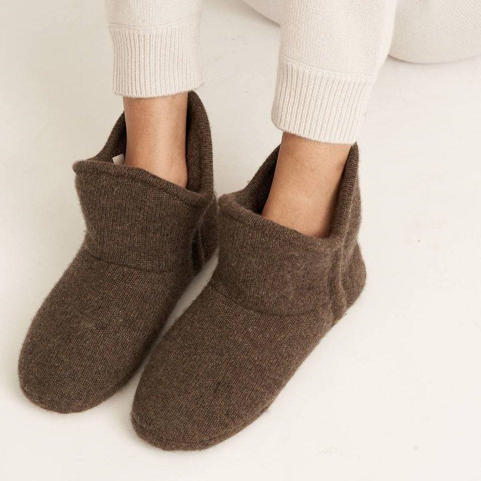 """She won't have to worry about cold feet anymore once these cashmere booties find a spot under the family tree. $185, Naked Cashmere. <a href=""""https://www.nakedcashmere.com/products/da-booties?variant=32235817467938"""" rel=""""nofollow noopener"""" target=""""_blank"""" data-ylk=""""slk:Get it now!"""" class=""""link rapid-noclick-resp"""">Get it now!</a>"""