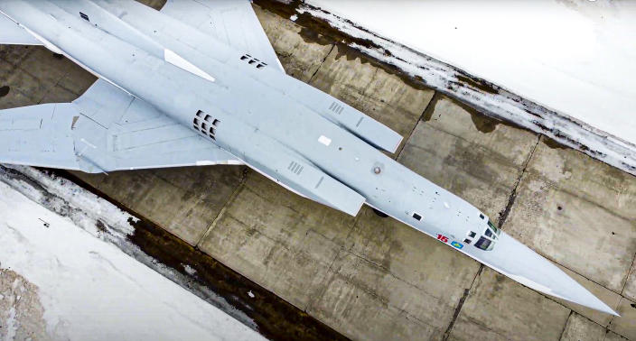 In this photo taken from a video provided by Russian Defense Ministry Press Service on Saturday, March 20, 2021, a Tu-22M3 bomber of the Russian air force takes off from an air base near Kaluga, Russia. During Tuesday's incident with a plane of the same type, three crew members died when their ejection seats accidentally activated during preflight checks. (Russian Defense Ministry Press Service via AP)