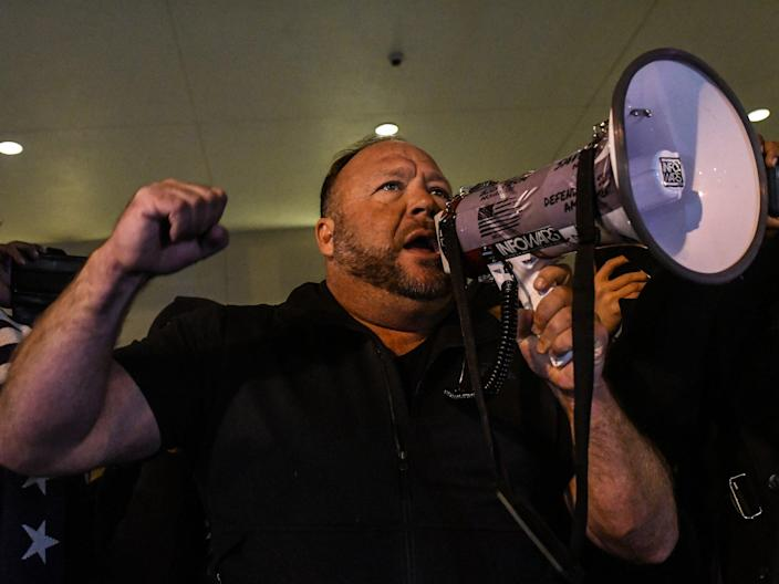 Alex Jones speaks to supporters of President Donald Trump during a protest on 12 December, 2020 in Washington, DC (Getty Images)