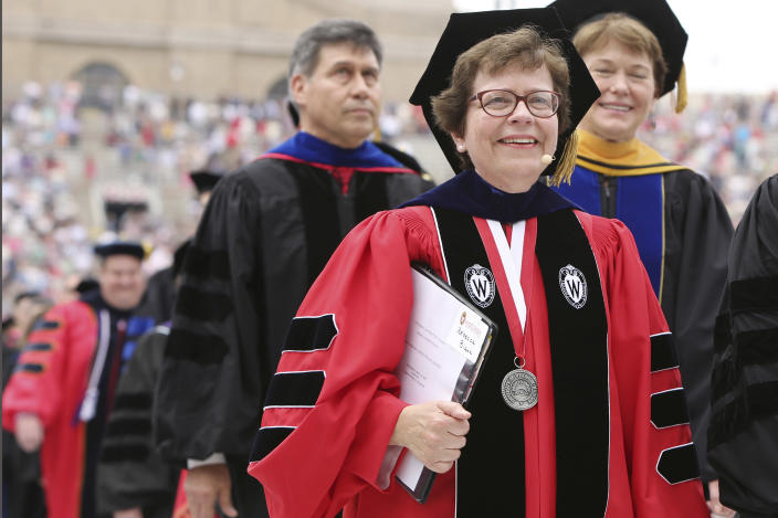 FILE - In this May 16, 2015 file photo, Chancellor Rebecca M. Blank, walks in a procession at the start of the University of Wisconsin-Madison spring commencement ceremony in Madison, Wis. A normal fall semester at the University of Wisconsin-Madison will depend on the pace of vaccinations for faculty, staff and students, Blank said Wednesday, March 3, 2021. (Amber Arnold/Wisconsin State Journal via AP, File)