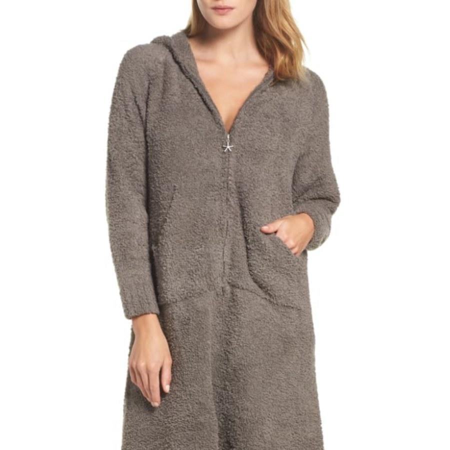 """<p>As cold weather sets in, it's tempting to crawl under the blankets the second you get home from work. But with <a href=""""https://click.linksynergy.com/deeplink?id=MZ9491VLjxM&mid=1237&u1=allurebestbathrobes&murl=https%3A%2F%2Fshop.nordstrom.com%2Fs%2Fbarefoot-dreams-cozychic-hooded-zip-robe%2F3912730%3Forigin%3Dcategory-personalizedsort%26breadcrumb%3DHome%2FWomen%2FClothing%2FSleepwear%2C%2520Lounge%2520%26%2520Robes%26color%3Dcharcoal"""" rel=""""nofollow"""">Barefoot Dreams' Cozy Chic Hooded Zip Robe</a>, you can swaddle yourself in the soothing feel of a microfiber blanket without getting trapped in bed. With a floor-length design and a hood to boot, you can beat the cold and still make dinner.</p> <p><em>One size only</em></p> <p><strong>$69</strong> (<a href=""""https://click.linksynergy.com/deeplink?id=MZ9491VLjxM&mid=1237&u1=allurebestbathrobes&murl=https%3A%2F%2Fshop.nordstrom.com%2Fs%2Fbarefoot-dreams-cozychic-hooded-zip-robe%2F3912730%3Forigin%3Dcategory-personalizedsort%26breadcrumb%3DHome%2FWomen%2FClothing%2FSleepwear%2C%2520Lounge%2520%26%2520Robes%26color%3Dcharcoal"""" rel=""""nofollow"""">Shop Now</a>)</p>"""