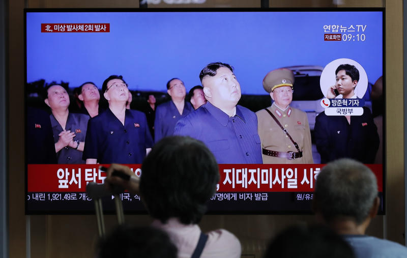 "People watch a TV news program reporting about North Korea's firing projectiles with a file image of North Korean leader Kim Jong Un at the Seoul Railway Station in Seoul, South Korea, Friday, Aug. 16, 2019. South Korea's military said Friday North Korea fired more projectiles into the sea to extend a recent streak of weapons tests believed to be aimed at pressuring Washington and Seoul over slow nuclear diplomacy. The letters read on the top ""North Korea, fired two unidentified projectiles."" (AP Photo/Lee Jin-man)"