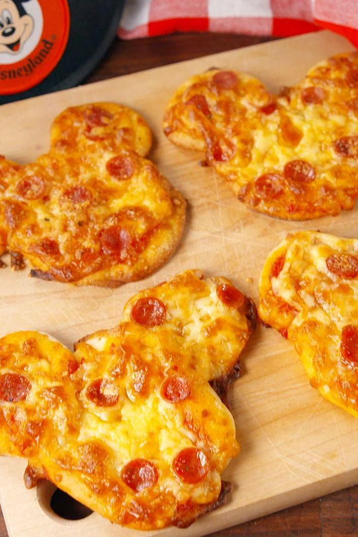 """<p>Mickey ears make these the cutest little pizzas.</p><p>Get the recipe from <a href=""""https://www.delish.com/cooking/recipe-ideas/recipes/a56094/mickey-pizzas-recipe/"""" rel=""""nofollow noopener"""" target=""""_blank"""" data-ylk=""""slk:Delish"""" class=""""link rapid-noclick-resp"""">Delish</a>. </p>"""
