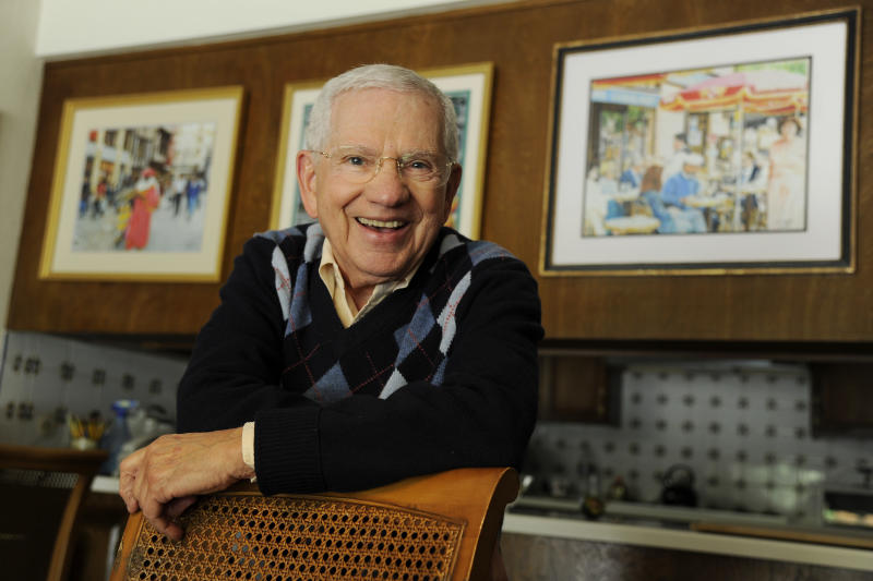 "In this Wednesday, Feb. 26, 2014 photo, actor, artist and singer Robert Clary poses near some of his paintings at his home in Beverly Hills, Calif. Clary, who starred in the sitcom ""Hogan's Heroes,"" turns 88 on Saturday, March 1, 2014. (Photo by Chris Pizzello/Invision/AP)"