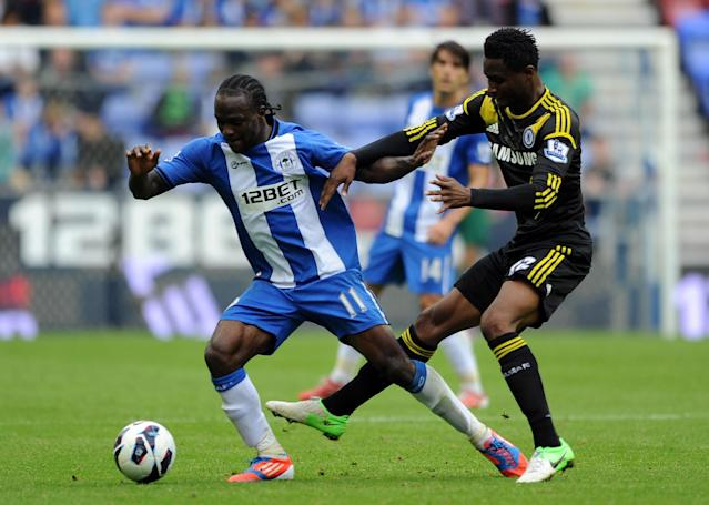 WIGAN, ENGLAND - AUGUST 19: John Obi Mikel (R) of Chelsea in action with Victor Moses of Wigan Athletic during the Barclays Premier League match between Wigan Athletic and Chelsea at DW Stadium on August 19, 2012 in Wigan, England. (Photo by Chris Brunskill/Getty Images)