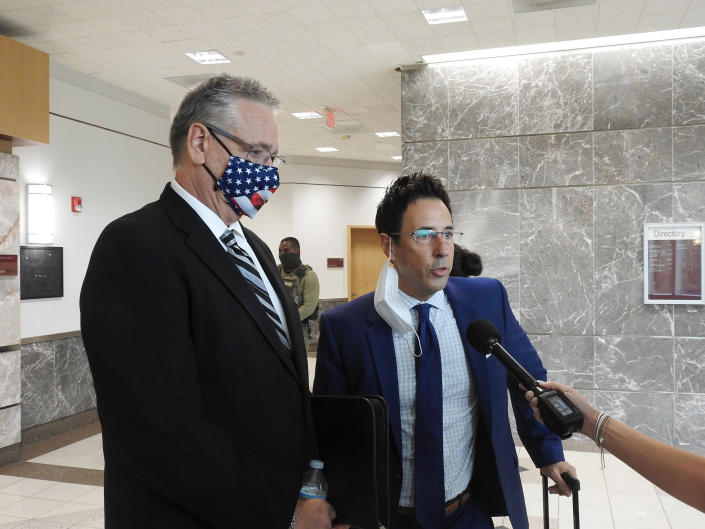 Former Broward County Deputy Scot Peterson, left, who was on duty during the Marjory Stoneman Douglas High School shooting in 2018 and his lawyer Mark Eiglarsh, right, are interviewed Wednesday, Aug. 18, 2021, in Fort Lauderdale, Fla. The former school resource officer accused of hiding during a South Florida school shooting that left 17 people dead said after a court hearing Wednesday that he never would have sat idle if he had known people were being killed.(Rafael Olmeda/South Florida Sun-Sentinel via AP)