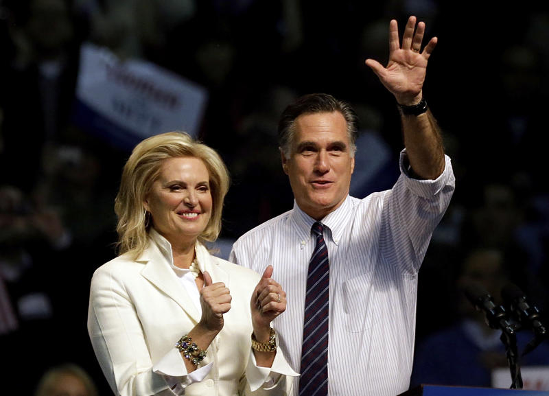 Republican presidential candidate, former Massachusetts Gov. Mitt Romney, right, takes the stage with wife Ann before speaking at a campaign event at the Verizon Wireless Arena, Monday, Nov. 5, 2012, in Manchester, N.H. (AP Photo/David Goldman)