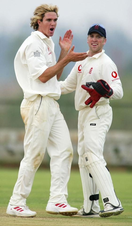 BANGALORE, INDIA - FEBRUARY 7:  England wicketkeeper Matthew Prior (R) celebrates with bowler Kevin Pietersen after a wicket fell during the Second One Day warm up game between Karnataka XI and England A at the Jain International School cricket ground on February 7, 2004 in Bangalore, India. (Photo by Stu Forster/Getty Images).