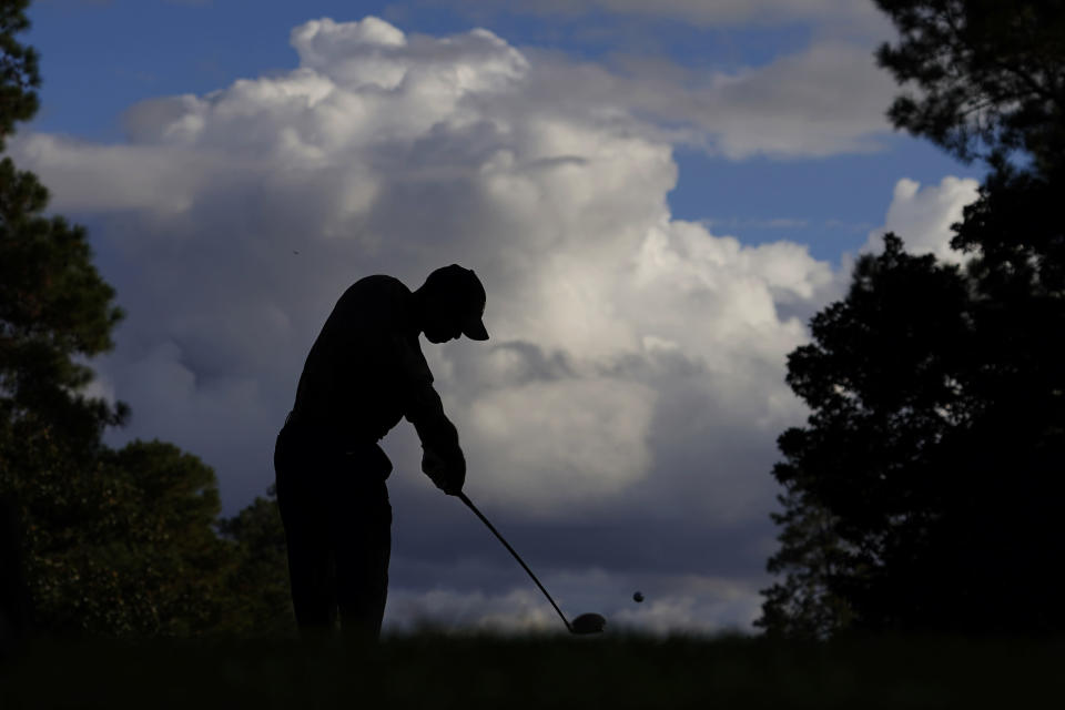 Tiger Woods tees off on the ninth hole during the first round of the Masters golf tournament Thursday, Nov. 12, 2020, in Augusta, Ga. (AP Photo/Charlie Riedel)