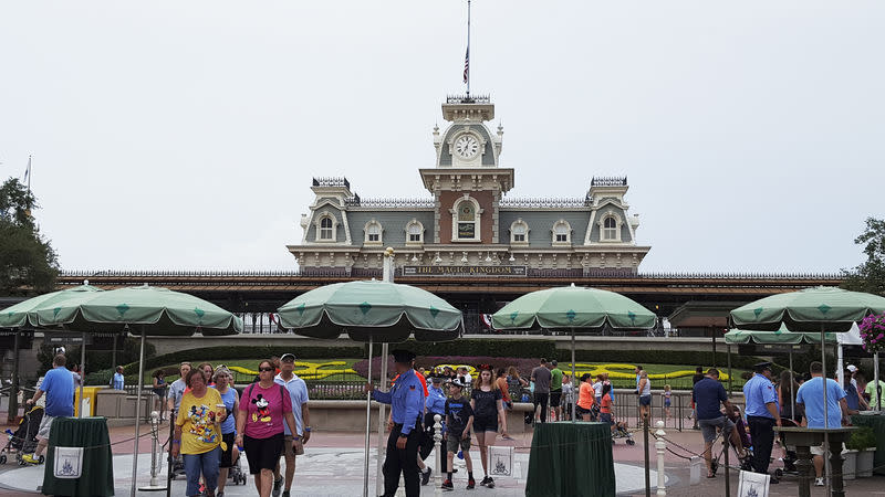 FILE PHOTO: Security officers staff the entrance at the Walt Disney World's Magic Kingdom in Orlando