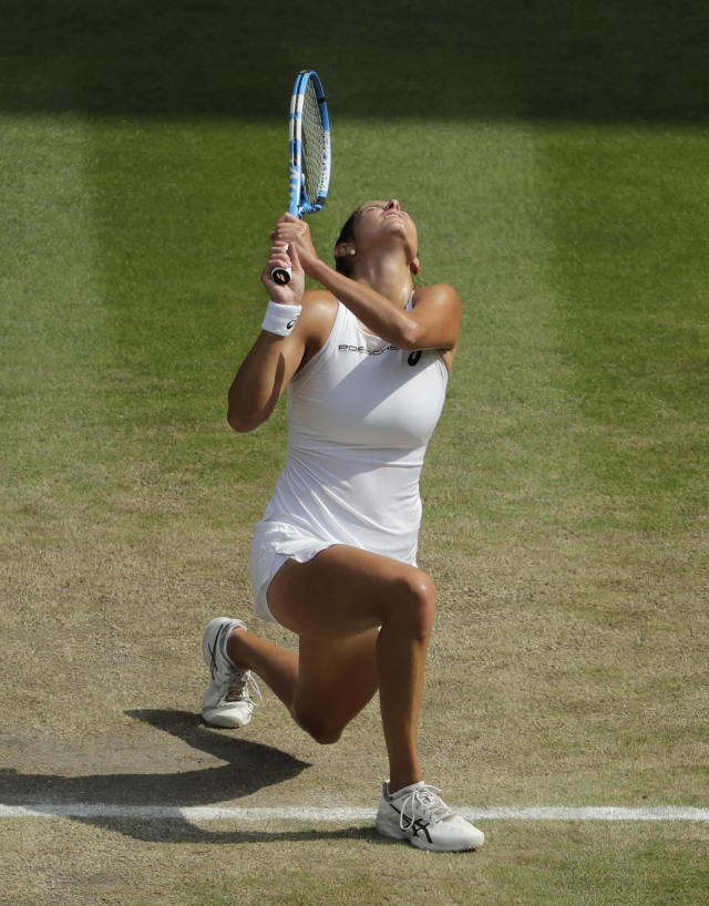 Julia Goerges of Germany loses a point to Serena Williams of the US during their women's semifinal match at the Wimbledon Tennis Championships in London, Thursday July 12, 2018. (AP Photo/Ben Curtis, Pool)