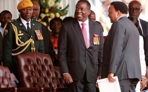 <span>Emmerson Mnangagwa, centre, takes his seat at his presidential inauguration ceremony in Harare, Zimbabwe</span> <span>Credit: AP </span>