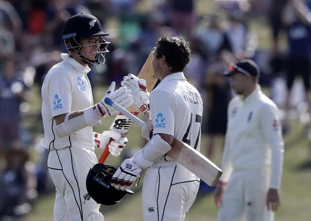 BJ Watling and Mitch Santner, left, took the game away from England (Mark Baker/AP)