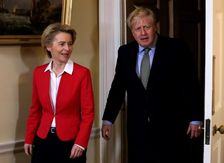 Boris Johnson, seen with European Commission President Ursula von der Leyen, now has a clear path to leave the EU after his decisive poll win (AFP Photo/Kirsty Wigglesworth)