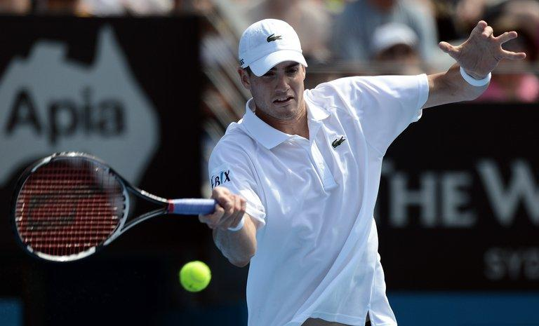 American John Isner returns a shot against compatriot Ryan Harrison at the Sydney International on January 9, 2013