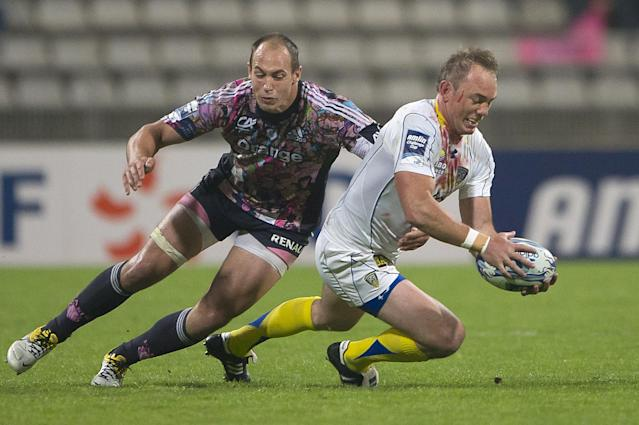 Stade Francais' number 8 Sergio Parisse (L) vies with Clermont's centre Marius Joubert during the European Challenge Cup semi final rugby union match Stade Francais vs. Clermont at the Charlety stadium in Paris on April 29, 2011. AFP PHOTO / BERTRAND LANGLOIS (Photo credit should read BERTRAND LANGLOIS/AFP/Getty Images)