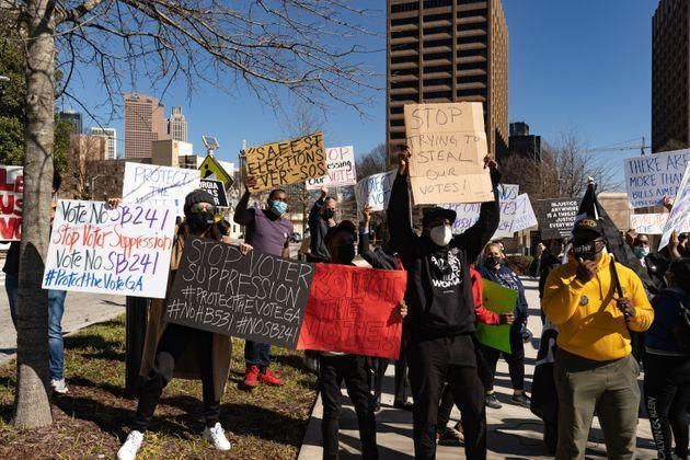 Protesters in Atlanta demonstrated against legislation that added new restrictions on voting to Georgia elections. In March, Republicans, who control the Georgia legislature, made Georgia one of the first states to pass a package of major voting restriction after last November's election. (Photo: Megan Varner via Getty Images)
