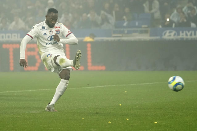 Lyon's Moussa Dembele scores against Nice during the French League One soccer match between Lyon and Nice, at Groupama stadium in Decines, near Lyon, central France, Saturday, Nov. 23, 2019. (AP Photo/Laurent Cipriani)