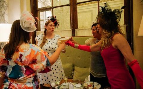 Guests toast at a Viewing Party at New York's Plaza Hotel - Credit: Getty