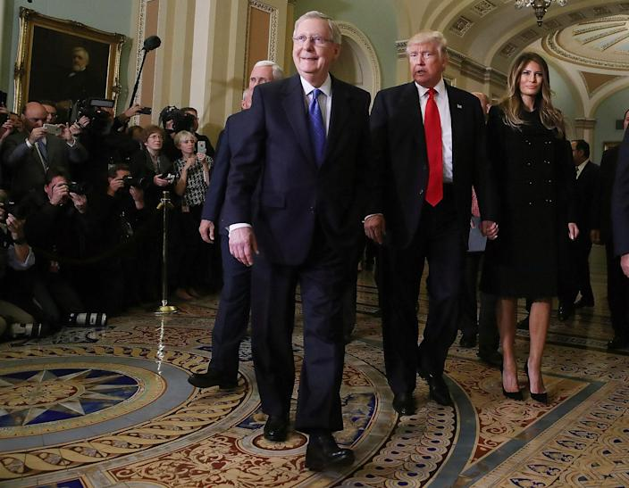 <p>Senate Majority Leader Mitch McConnell walks with President-elect Donald Trump; his wife, Melania Trump; and Vice President-elect Mike Pence at the U.S. Capitol for a meeting on Nov. 10, 2016, in Washington. (Mark Wilson/Getty Images) </p>