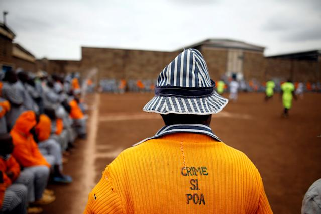 "<p>A Kenyan prisoner wearing a shirt with the words ""Crime is not good"" watches a mock World Cup soccer match between Russia and Saudi Arabia during a monthlong soccer tournament at the Kamiti Security Maximum Prison, near Nairobi, on June 14, 2018. (Photo: Baz Ratner/Reuters) </p>"
