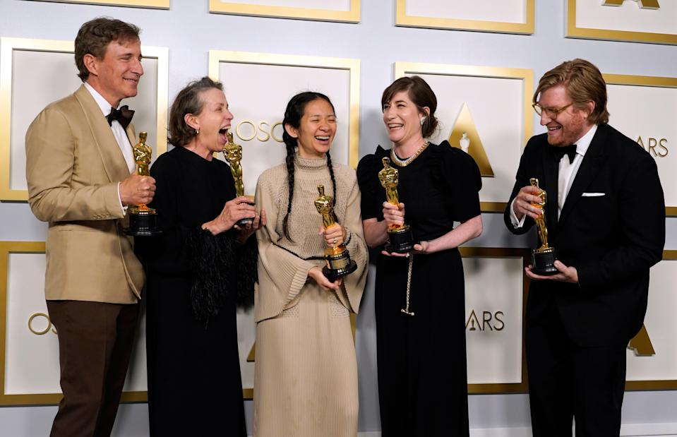 Producers Peter Spears, from left, Frances McDormand, Chloe Zhao, Mollye Asher and Dan Janvey, winners of the award for best picture for 'Nomadland'AP