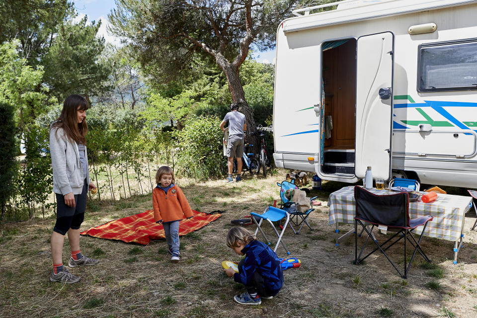 A family enjoys a weekend with their motorhome at the Monte Holiday campsite on June 13, 2020, in Gargantilla de Lozoya y Pinilla de Buitrago, Spain. (Photo by Carlos Alvarez/Getty Images)