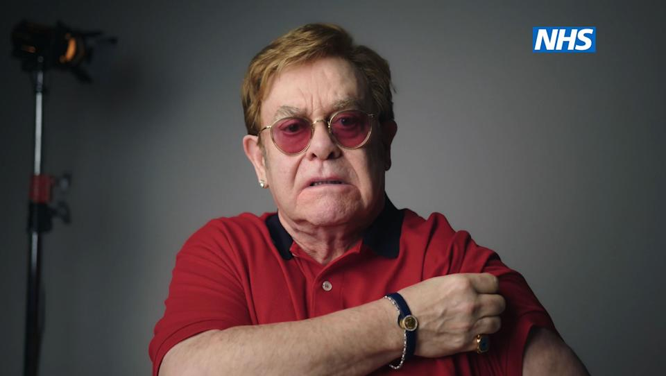 Undated handout screengrab issued by NHS England of Sir Elton John as he stars, with Sir Michael Caine, in the new video to encourage people to get vaccinated against coronavirus. Issue date: Wednesday February 10, 2021.