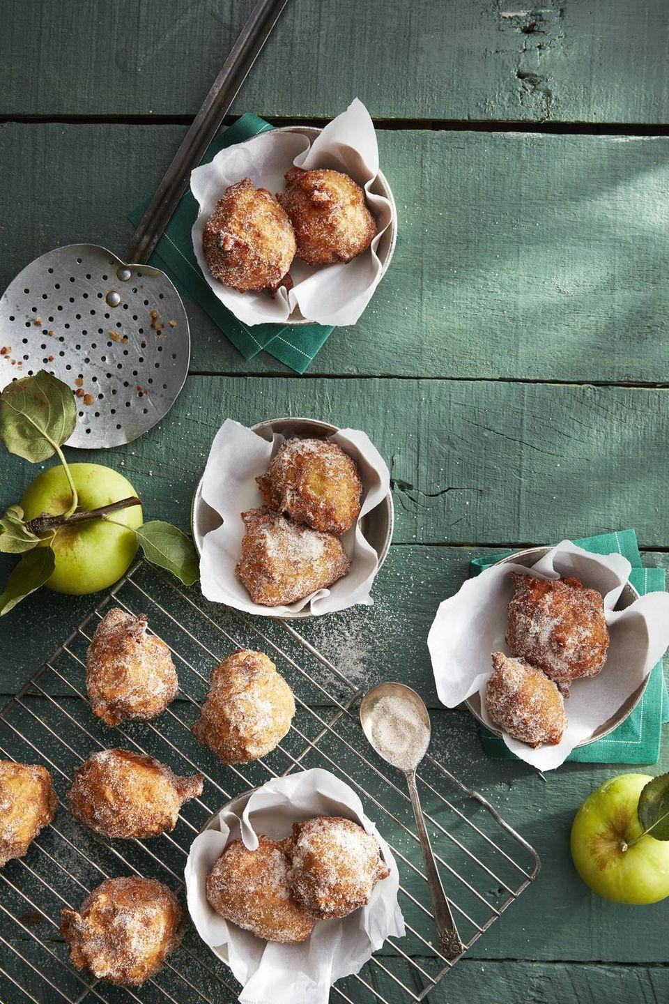 "<p>Pretend like you're hosting Thanksgiving at the apple orchard and fry up apple cider doughnuts.</p><p><em><a href=""https://www.countryliving.com/food-drinks/a23390937/pie-spiced-apple-fritters-recipe/"" rel=""nofollow noopener"" target=""_blank"" data-ylk=""slk:Get the recipe from Country Living »"" class=""link rapid-noclick-resp"">Get the recipe from Country Living »</a></em></p>"