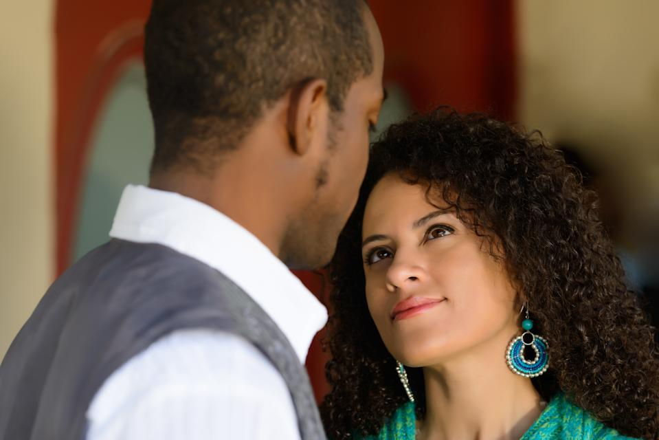 A young couple in conversation, verbal and nonverbal.