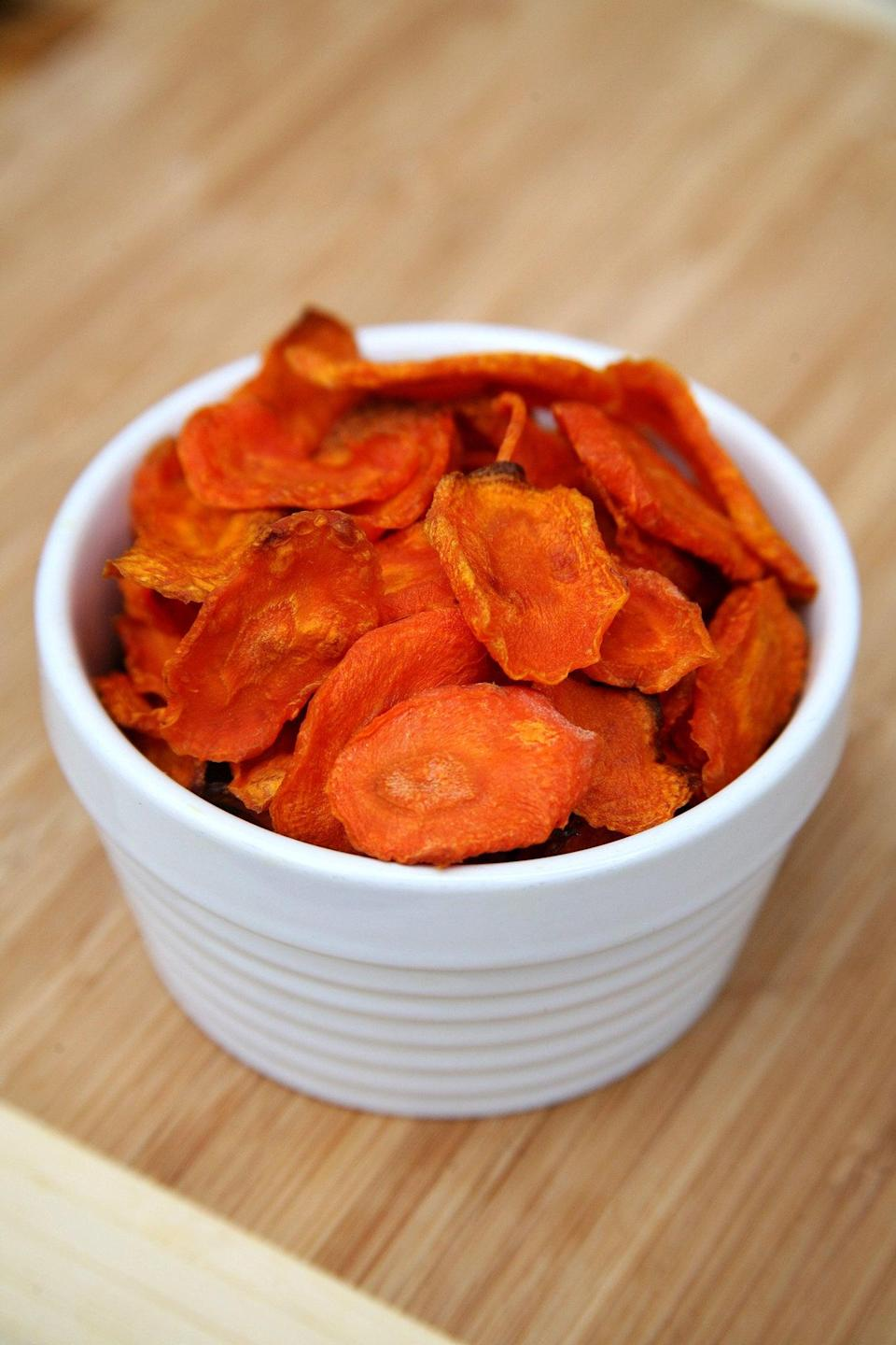 """<p>Made with carrots and baked instead of fried, these crunchy gems are a much healthier alternative to traditional potato chips.</p> <p><strong>Get the recipe:</strong> <a href=""""https://www.popsugar.com/fitness/Carrot-Chips-Recipe-34719564"""" class=""""link rapid-noclick-resp"""" rel=""""nofollow noopener"""" target=""""_blank"""" data-ylk=""""slk:baked carrot chips"""">baked carrot chips</a></p>"""