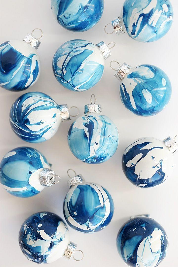 """<p>It's a standard beauty supply—nail polish!—that gives these ornaments their Pinterest-worthy marbled look. </p><p><em>Get the tutorial at <a href=""""https://www.aliceandlois.com/diy-indigo-marbled-ornaments/"""" rel=""""nofollow noopener"""" target=""""_blank"""" data-ylk=""""slk:Alice and Lois"""" class=""""link rapid-noclick-resp"""">Alice and Lois</a>.</em></p><p><a class=""""link rapid-noclick-resp"""" href=""""https://www.amazon.com/essie-Polish-Limited-Collection-Waterfall/dp/B08B6WNFGK?tag=syn-yahoo-20&ascsubtag=%5Bartid%7C10072.g.34443405%5Bsrc%7Cyahoo-us"""" rel=""""nofollow noopener"""" target=""""_blank"""" data-ylk=""""slk:SHOP NAIL POLISH"""">SHOP NAIL POLISH</a></p>"""