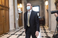 Sen. David Perdue, R-Ga., arrives for votes during a rare weekend session to advance the confirmation of Judge Amy Coney Barrett to the Supreme Court, at the Capitol in Washington, Sunday, Oct. 25, 2020. (AP Photo/J. Scott Applewhite)