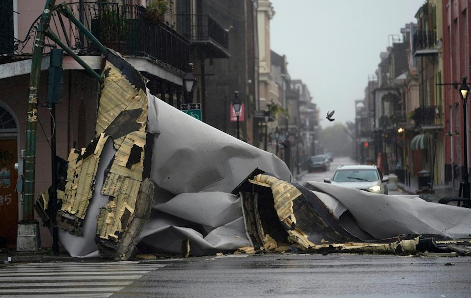 A section of roof that was blown off of a building in the French Quarter (AP Photo/Eric Gay)