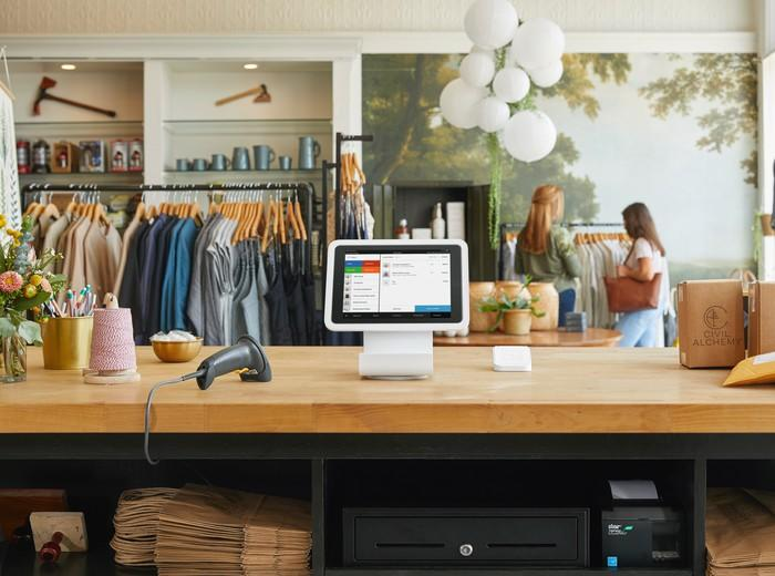 The Square point-of-sale system on the counter in a retail apparel store.