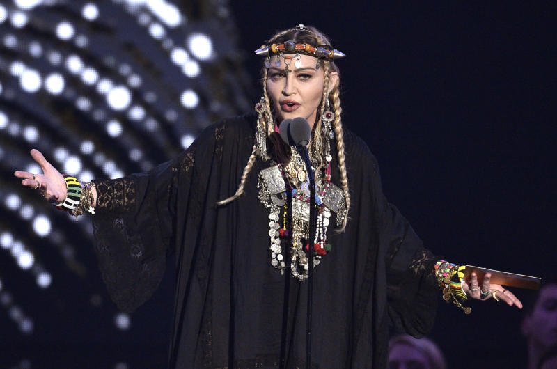 """FILE - In this Aug. 20, 2018 file photo, Madonna presents a tribute to Aretha Franklin at the MTV Video Music Awards at Radio City Music Hall in New York. Eurovision Song Contest organizers said on Sunday, May 19, 2019,  they were taken aback by the display of a Palestinian flag during Madonna's guest appearance, which defied contest rules. While Madonna performed her new single at the contest, hosted in Tel Aviv, two of her dancers onstage flashed Israeli and Palestinian flags pinned on their backs. The European Broadcast Union, or EBU, said that Madonna had not cleared that part of the act with broadcasters and """"was advised as to the non-political nature of the event.""""  (Photo by Chris Pizzello/Invision/AP, File)"""