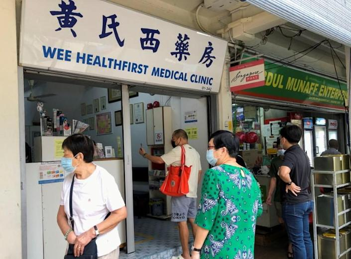 People queue to enquire about Sinovac vaccine at a clinic, during the coronavirus disease (COVID-19) outbreak in Singapore