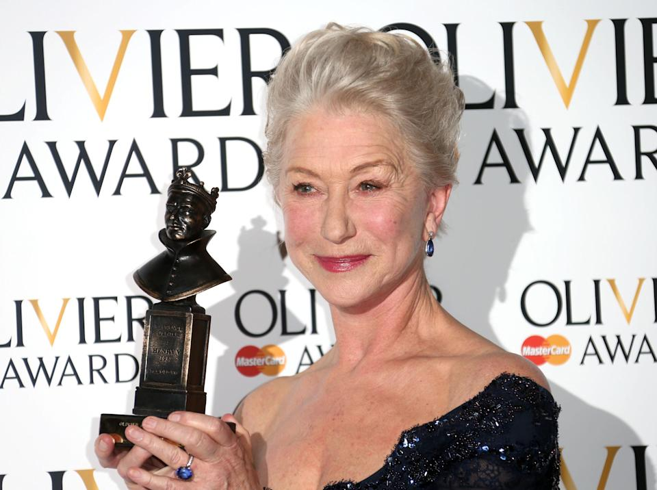 """FILE - This is a Sunday, April 28, 2013 file photo of Helen Mirren winner of Best Actress Award for The Audience in the press room at the Olivier Awards 2013 at the Royal opera House in London. Mirren's award-winning performance as Queen Elizabeth II in """"The Audience"""" will be beamed this week from London's Gielgud Theatre to hundreds of movie theaters around the world in a live broadcast. (Photo by Joel Ryan/Invision/AP, File)"""